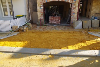 New layer of yellow sand ready for the driveway